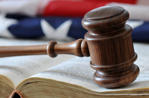 How does an HOA property manager handle legal issues?