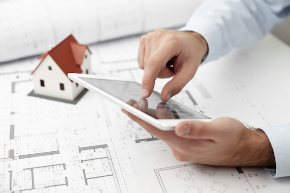 Architect with mini tablet