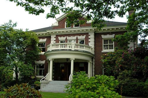 Large white portico, brick house, Washington Park neighborhood, Seattle, Washington, USA