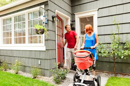 family leaving rental house